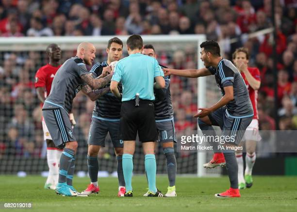 Celta Vigo players speak to the referee after the matchball is burst following a tackle involving Manchester United's Daley Blind during the UEFA...