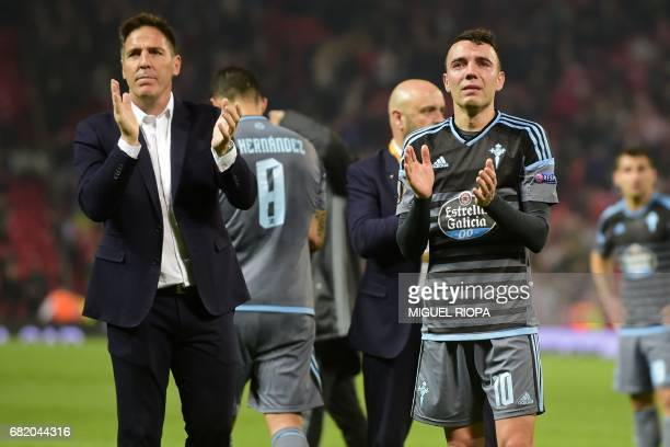 Celta Vigo's Argentinian coach Eduardo Berizzo and Celta Vigo's Spanish striker Iago Aspas react on the pitch to their defeat in the tie after the...