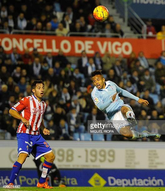 Celta Vigo's Belgian forward Theo Bongonda kicks the ball next to Sporting Gijon's midfielder Jony during the Spanish league football match RC Celta...