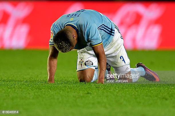 Celta Vigo's Belgian forward Theo Bongonda takes his breathe as he kneels on the pitch during the Spanish league football match Villarreal CF vs RC...