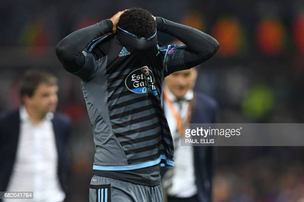 Celta Vigo's Belgian midfielder Theo Bongonda reacts on the pitch to their defeat in the tie after the UEFA Europa League semifinal secondleg...