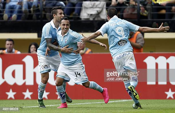 Celta Vigo's Chilean forward Fabian Orellana celebrates with teammates after scoring during the Spanish league football match Villarreal CF vs RC...