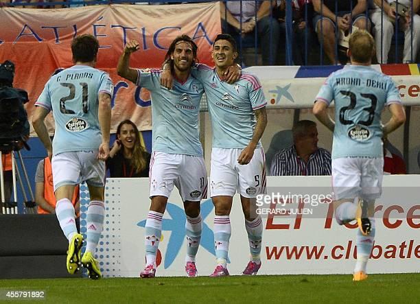 Celta Vigo's Chilean midfielder Pablo Hernandez celebrates after scoring with Celta Vigo's Argentinian forward Joaquin Larrivey during the Spanish...