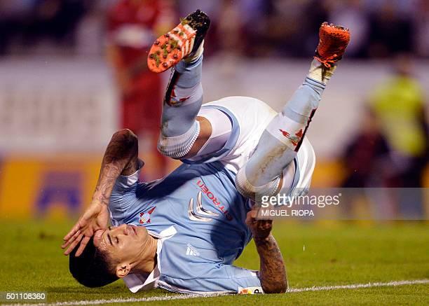 Celta Vigo's Chilean midfielder Pablo Hernandez falls down during the Spanish league football match Celta Vigo vs Real CD Espanyol at the Balaidos...