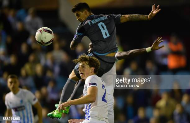 Celta Vigo's Chilean midfielder Pablo Hernandez heads the ball next to Genk's Norwegian midfielder Sander Berge during the UEFA Europa League quarter...