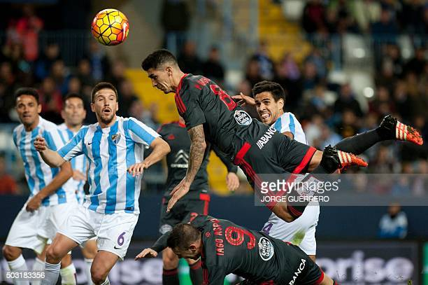 Celta Vigo's Chilean midfielder Pablo Hernandez heads the ball past Malaga's midfielder Ignacio Camacho during the Spanish league football match...