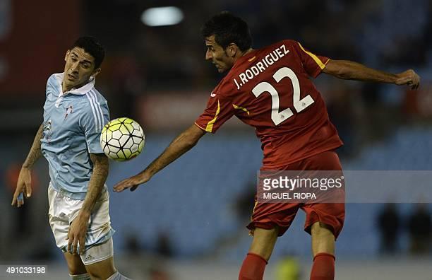 Celta Vigo's Chilean midfielder Pablo Hernandez vies with Getafe's midfielder Juan Rodriguez during the Spanish league football match Celta Vigo vs...