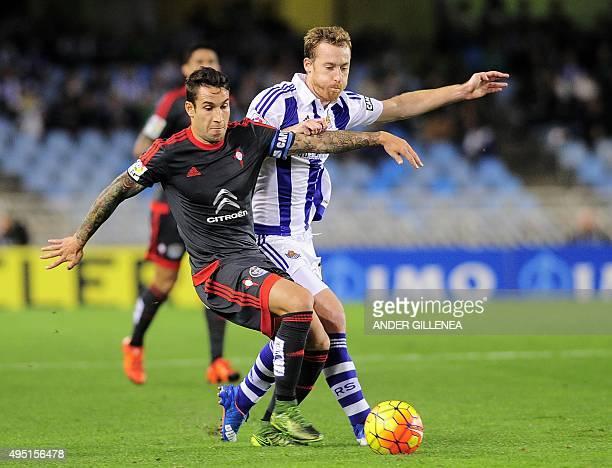 Celta Vigo's Chilean midfielder Pablo Hernandez vies with Real Sociedad's midfielder David Zurutuza during the Spanish league football match Real...