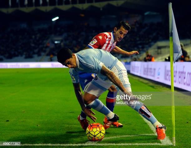 Celta Vigo's Chilean midfielder Pablo Hernandez vies with Sporting Gijon's defender Luis Hernandez during the Spanish league football match RC Celta...