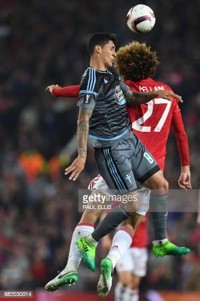Celta Vigo's Chilean midfielder Pedro Pablo Hernandez vies with Manchester United's Belgian midfielder Marouane Fellaini during the UEFA Europa...