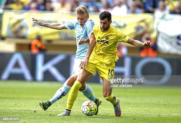 Celta Vigo's Danish defender Daniel Wass vies with Villarreal's Brazilian forward Leonardo Carrilho Baptistao during the Spanish league football...