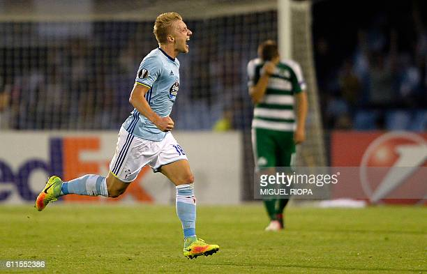 Celta Vigo's Danish midfielder Daniel Wass celebrates after scoring a goal during the Europa League Group G football match RC Celta de Vigo vs...