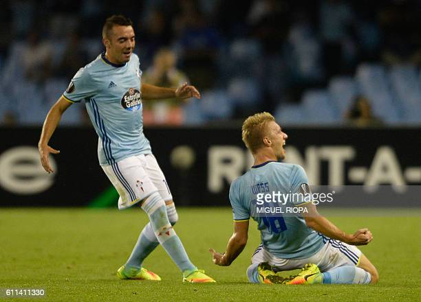 Celta Vigo's Danish midfielder Daniel Wass celebrates with teammate forward Iago Aspas after scoring a goal during the Europa League Group G football...