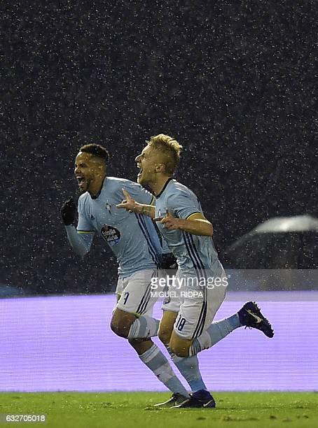 Celta Vigo's Danish midfielder Daniel Wass celebrates with teammate Belgian forward Theo Bongonda after scoring during the Spanish Copa del Rey...