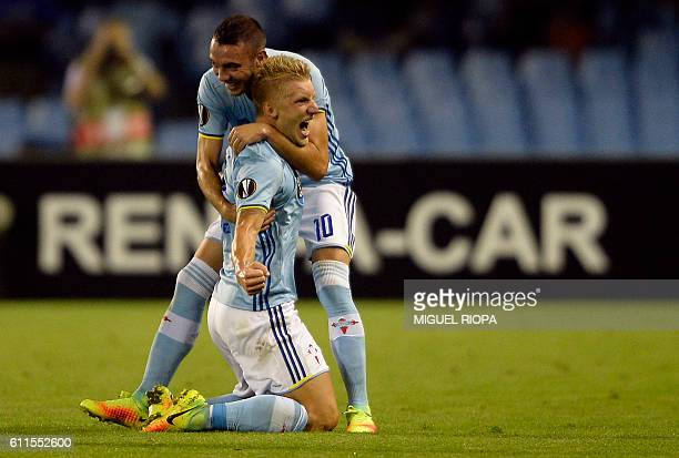 Celta Vigo's Danish midfielder Daniel Wass is congratulated by teammate forward Iago Aspas after scoring a goal during the Europa League Group G...