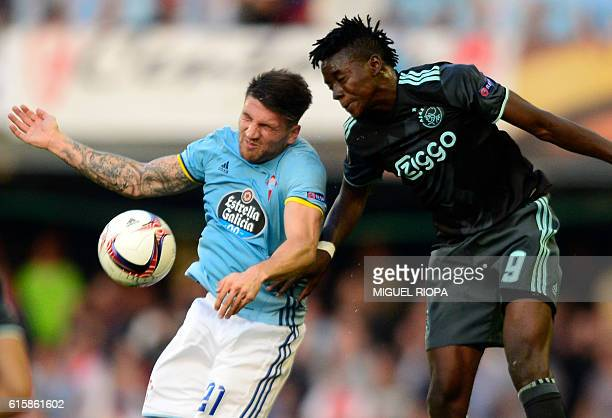 Celta Vigo's defender Carles Planas jumps for the ball with Ajax's Burkinabe forward Bertrand Traore during the Europa League football match RC Celta...