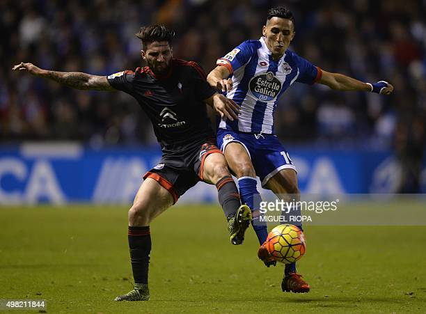Celta Vigo's defender Carles Planas vies with Deportivo La Coruna's Moroccan midfielder Faycal Fajr during the Spanish league football match RC...