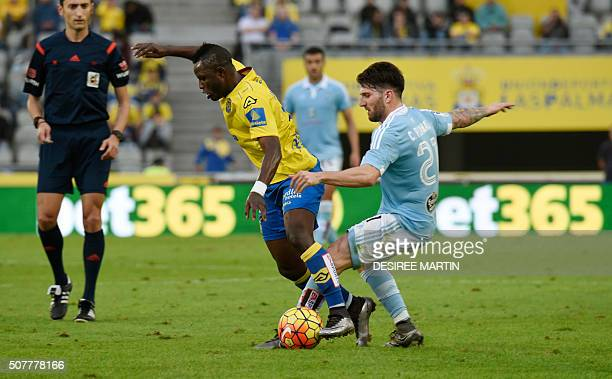 Celta Vigo's defender Carles Planas vies with Las Palmas' Ghanaian midfielder Wakaso Mubarak during the Spanish league football match UD Las Palmas...