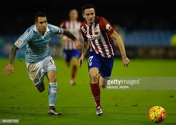 Celta Vigo's defender Hugo Mallo vies with Atletico Madrid's midfielder Saul Niguez during the Spanish league football match RC Celta de Vigo vs Club...