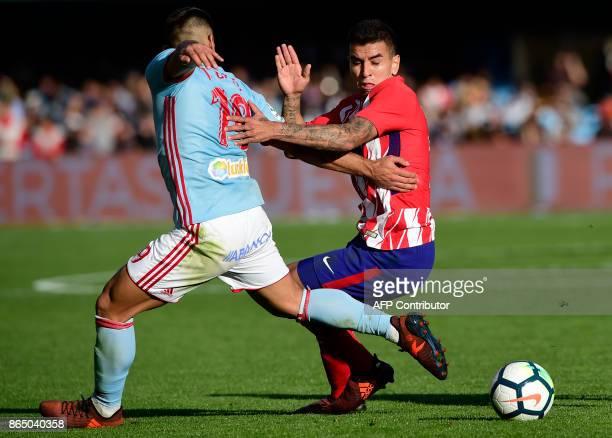 Celta Vigo's defender Jonny Castro vies with Atletico Madrid's Argentinian midfielder Angel Correa during the Spanish league football match RC Celta...
