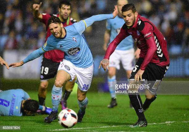 Celta Vigo's defender Sergi Gomez vies with Alaves' French defender Theo Hernandez during the Spanish Copa del Rey semi final first leg football...