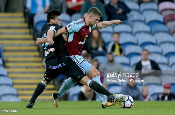 Celta Vigo's Facundo Roncaglia and Burnley's Johann Berg Gudmundsson battle for the ball during the preseason friendly match at Turf Moor Burnley