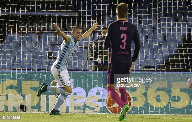Celta Vigo's forward Iago Aspas celebrates after scoring a goal during the Spanish league football match RC Celta de Vigo vs FC Barcelona at the...
