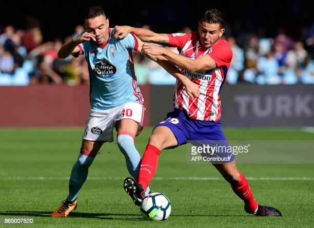 Celta Vigo's forward Iago Aspas vies with Atletico Madrid's French defender Lucas Hernandez during the Spanish league football match RC Celta de Vigo...
