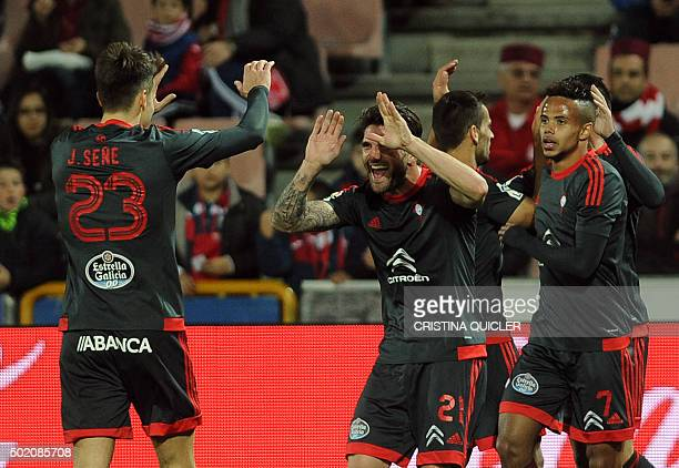 Celta Vigo's forward Josep Sene celebrates with Celta Vigo's defender Carles Planas after scoring during the Spanish league football match Granada FC...