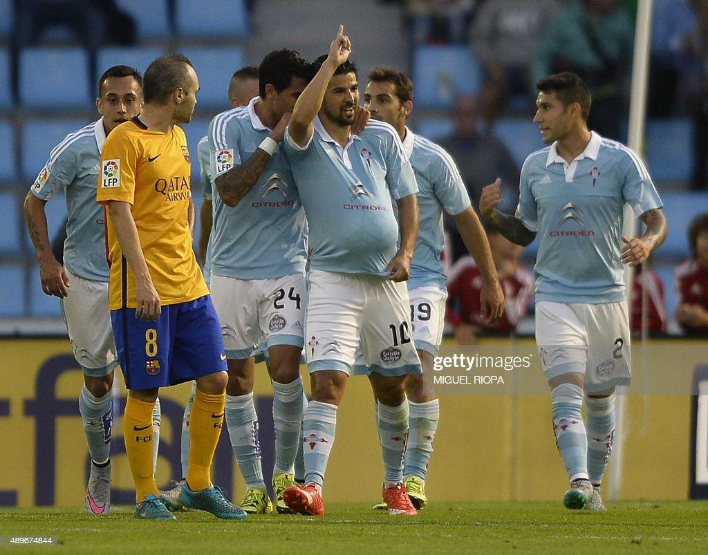 Celta Vigo's forward Nolito celebrates after scoring a goal during the Spanish league football match Celta Vigo vs FC Barcelona at the Balaidos...