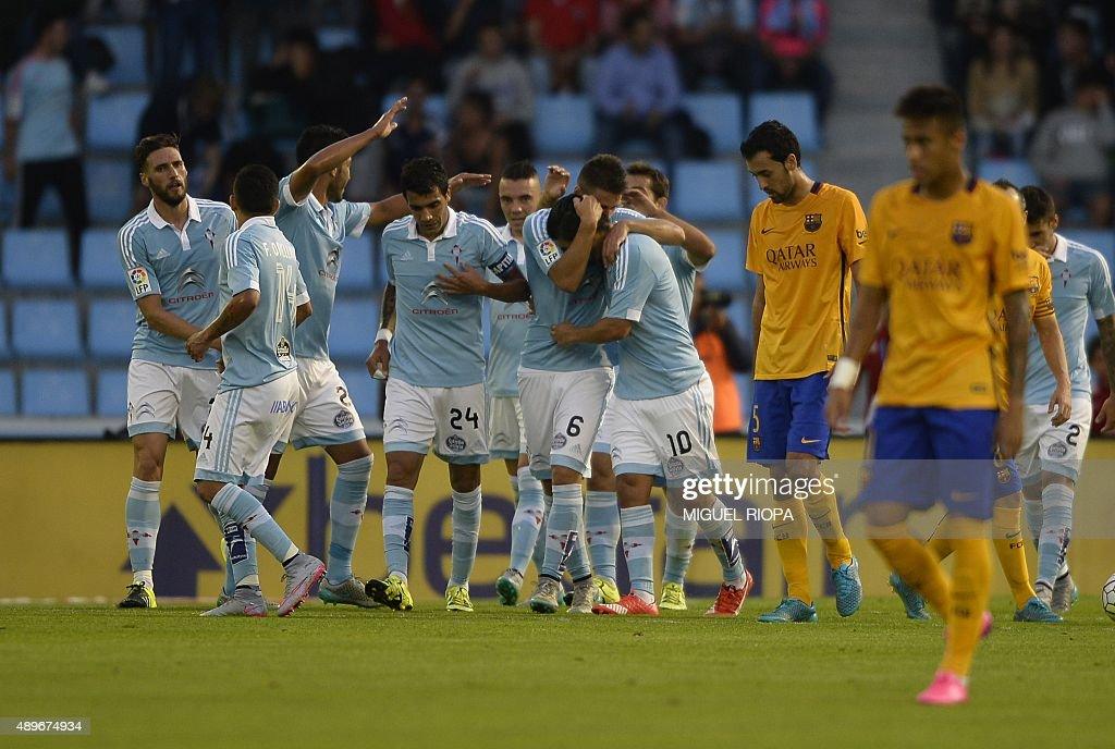 Celta Vigo's forward Nolito celebrates with teammates after scoring a goal during the Spanish league football match Celta Vigo vs FC Barcelona at the...