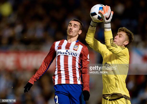Celta Vigo's goalkeeper Ruben Blanco Veiga gets the ball next to Atletico Madrid's French forward Antoine Griezmann during the Spanish Copa del Rey...
