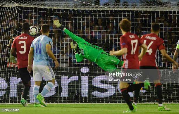 Celta Vigo's goalkeeper Sergio Alvarez fails to stop the goal scored by Manchester United's forward Marcus Rashford during their UEFA Europa League...