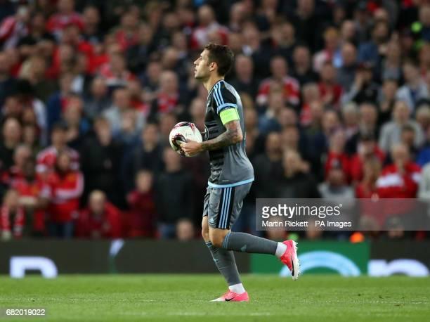 Celta Vigo's Novegil Hugo Mallo carries a burst matchball following a tackle involving Manchester United's Daley Blind during the UEFA Europa League...