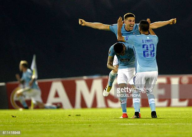 Celta Vigo's players celebrate the opening goal during the Europa League Group G football match RC Celta de Vigo vs Panathinaikos FC at the Balaidos...