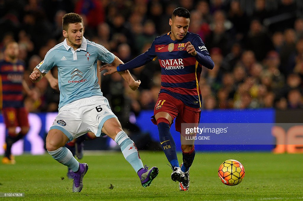 Celta Vigo's Serbian midfielder Nemanja Radoja (L) vies with Barcelona's Barcelona's Brazilian forward Neymar during the Spanish league football match FC Barcelona vs RC Celta de Vigo at the Camp Nou stadium in Barcelona on February 14, 2016. GENE
