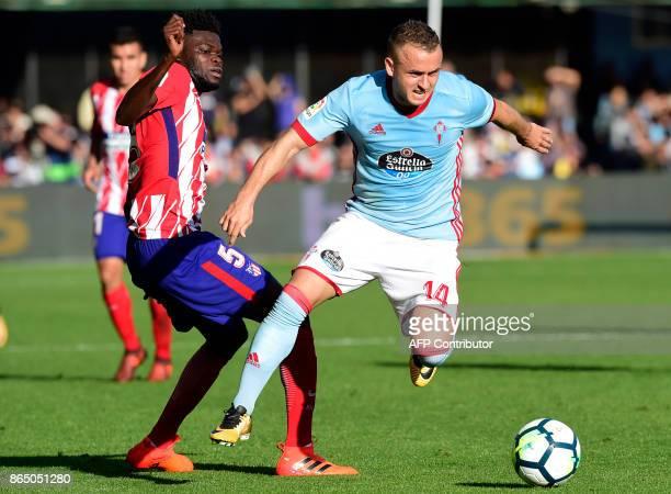 Celta Vigo's Slovak midfielder Stanislav Lobotka vies with Atletico Madrid's Ghanaian midfielder Thomas Partey during the Spanish league football...