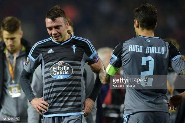 Celta Vigo's Spanish striker Iago Aspas and Celta Vigo's Spanish defender Hugo Mallo react on the pitch to their defeat in the tie after the UEFA...
