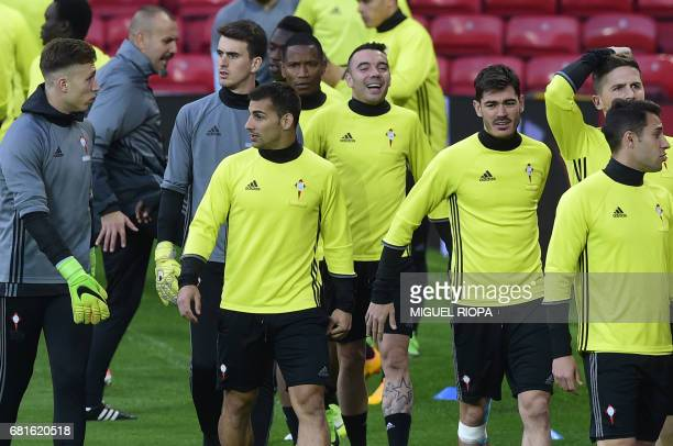 Celta Vigo's Spanish striker Iago Aspas jokes with his teammates during a training session at Old Trafford in Manchester north west England on May 10...