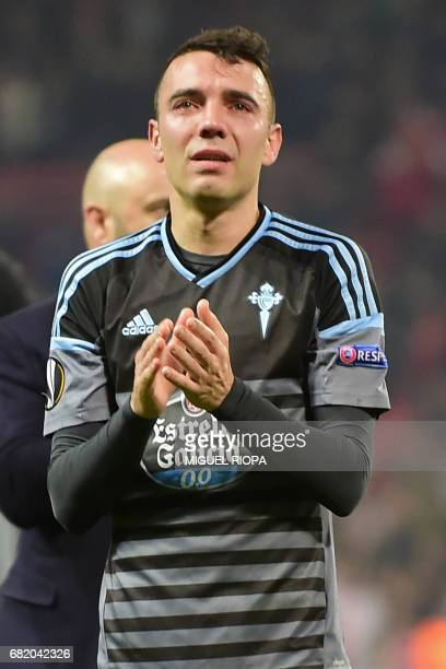 Celta Vigo's Spanish striker Iago Aspas reacts on the pitch to their defeat in the tie after the UEFA Europa League semifinal secondleg football...