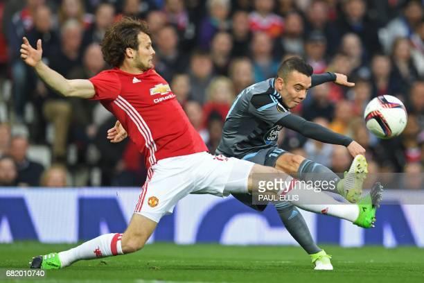 Celta Vigo's Spanish striker Iago Aspas shoots past Manchester United's Dutch midfielder Daley Blind during the UEFA Europa League semifinal...