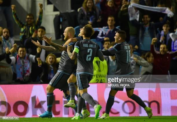 Celta Vigo's Swedish forward John Guidetti celebrates with teammates after scoring a goal during the UEFA Europa League quarter final 1st leg...