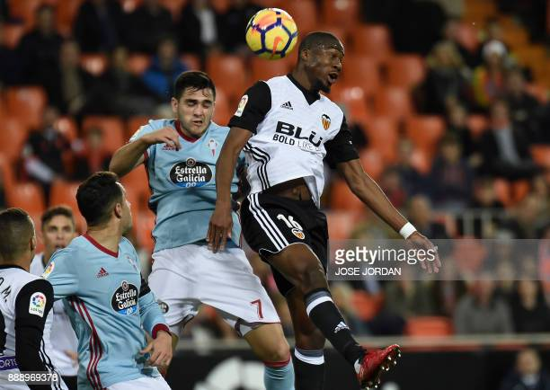 Celta Vigo's Uruguayan forward Maxi Gomez vies with Valencia's French midfielder Geofrey Kondogbia during the Spanish league football match between...