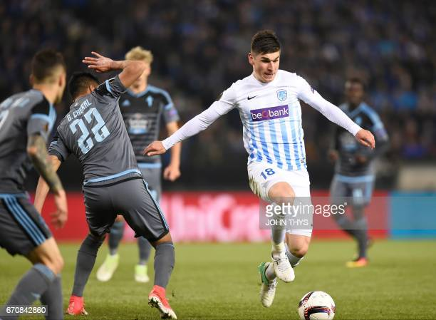Celta's Argentinian defender Gustavo Cabral vies with Genk's miedfielder Ruslan Malinovsky during the UEFA Europa League quarter final second leg...
