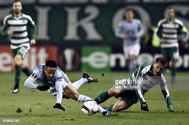 Celta's Belgian forward Theo Bongonda fights for the ball with Panathinaikos' Finish midfielder Robin Lod during the UEFA Europa League football...