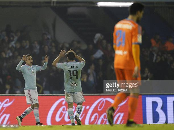 Celta's Chilean forward Fabian Orellana celebrates with teammate defender Jonny Castro after scoring a goal during the Spanish league football match...