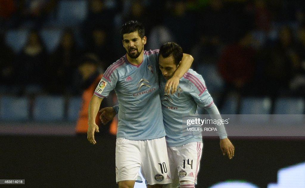 Celta's Chilean forward Fabian Orellana is congratulated by teammate forward Nolito after scoring a goal during the Spanish league football match RC...