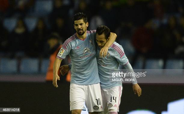 Celta's Chilean forward Fabian Orellana is congratulated by teammate forward Nolito after scoring a goal during the Spanish league football match RC...