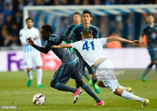 Celta's Danish forward Pione Sisto vies with Genk's defender Timothy Castagne during the UEFA Europa League quarter final match between KRC Genk and...