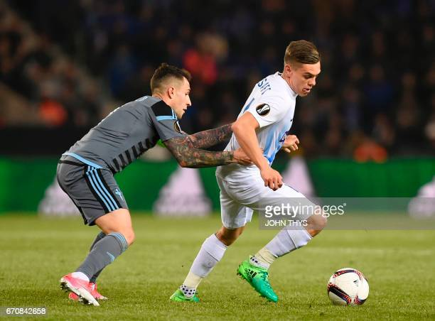Celta's defender Hugo Mallo vies with Genk's forward Leandro Trossard during the UEFA Europa League quarter final second leg football match KRC Genk...